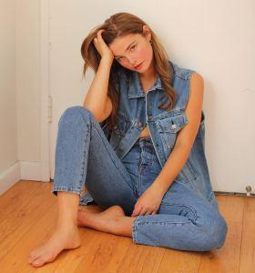 Stefanie Scott in denim jacket and pants