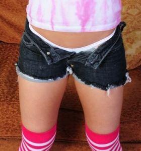 Taylor Lain in denim cut off shorts